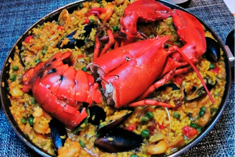 paella with lobster in a paella pan