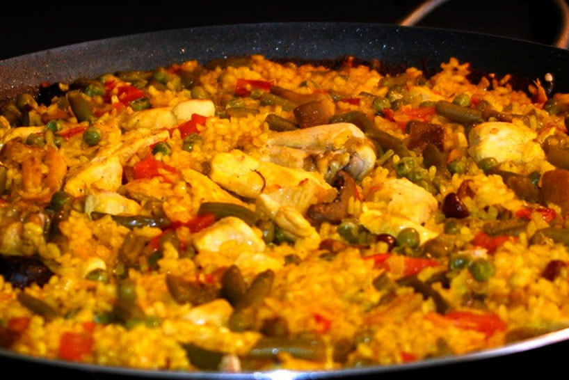 Paella with Rabbit with rice in a paella pan